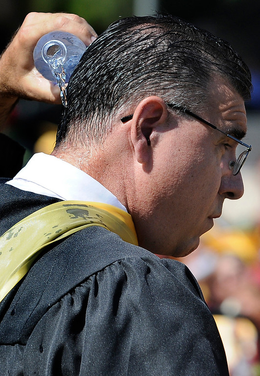 . Calculus teacher Tim Peter cools himself off while helping graduates reach the stage. The Commencement Exercises for the Bishop Alemany High School Class of 2013 was held at College of the Canyons in Santa Clarita, CA 6/1/2013(John McCoy/LA Daily News)