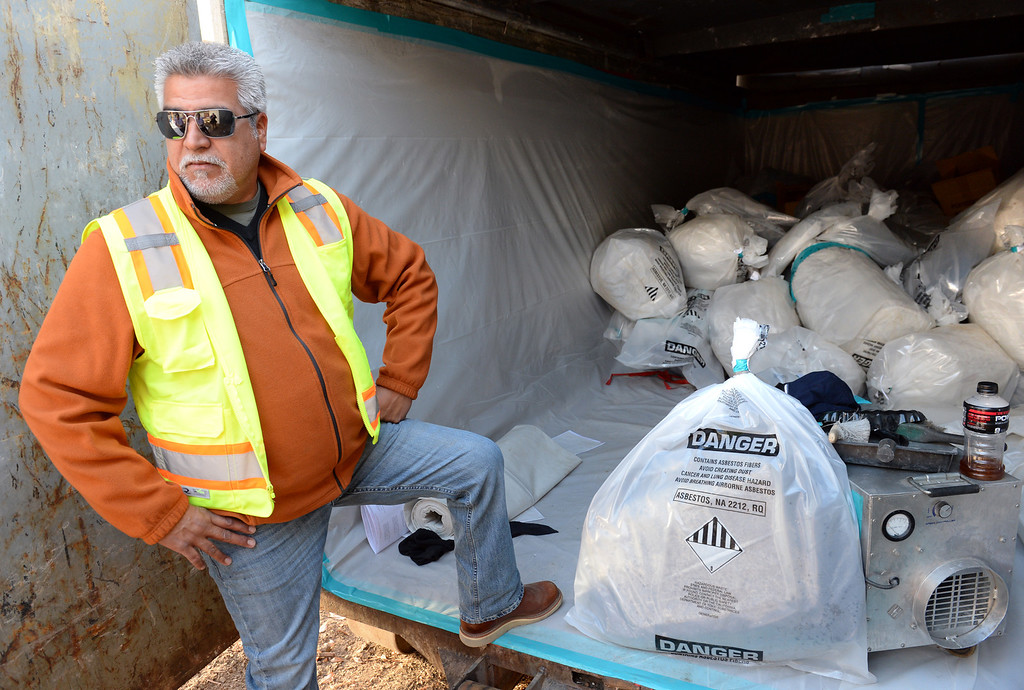 . Ernie Valdez with Resource Environmental, Inc. shows Asbestos that was packaged up and removed from La Habra Heights City Hall on Wednesday January 22, 2014. More asbestos was found in the roofing material last week. (Staff Photo by Keith Durflinger/Pasadena Star-News)