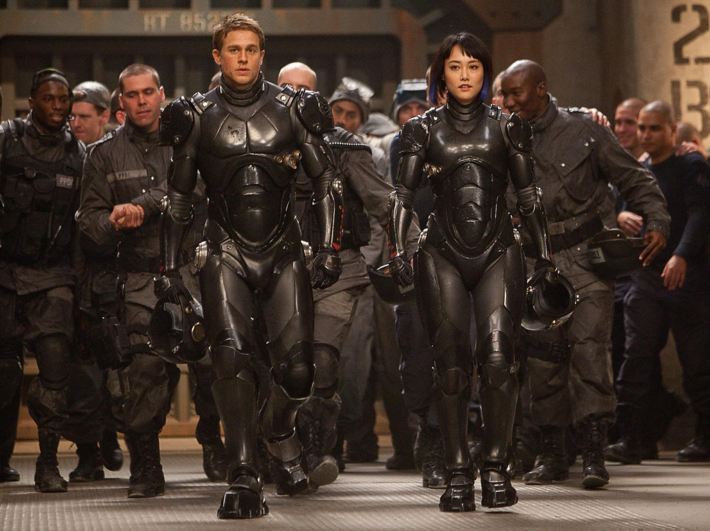 """. Rinko Kikuchi stands out mainly because she\'s the only female among a group of indistinguishable actors playing giant monster-fighting robot pilots in Warner Bros.\' \""""Pacific Rim,\"""" out July 12."""