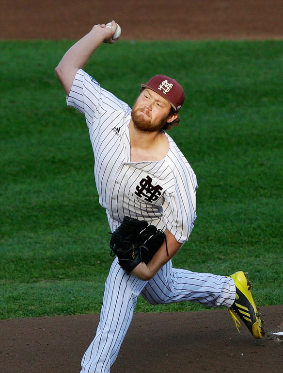 . Mississippi State starting pitcher Trevor Fitts works against UCLA in the first inning of Game 1 of the NCAA College World Series best-of-three finals, in Omaha, Neb., Monday, June 24, 2013. (AP Photo/Nati Harnik)