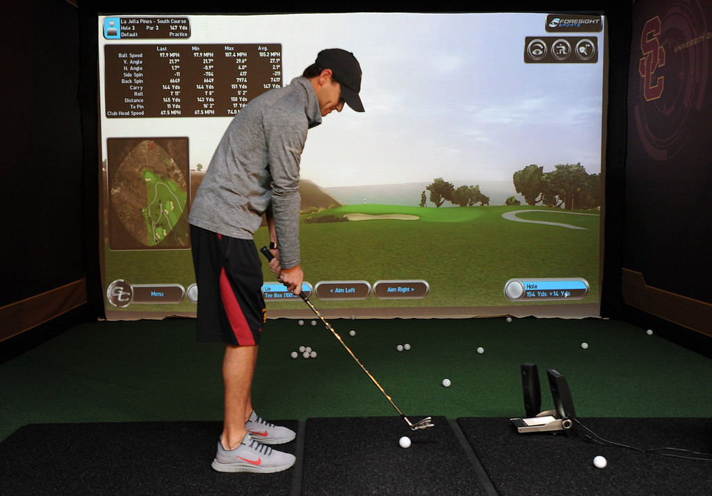. Women\'s Assistant Golf Coach Justin Silverstein uses the indoor golf simulator that features over 500 golf courses. Heritage Hall, which houses USC\'s athletic department, has been closed for the past year while undergoing a $35-million renovation.  The building first opened in 1971 at a cost of $2.8 million and was originally 48,000 square feet. It now is 80,000 square feet. As part of the renovation, Heritage Hall\'s two-story lobby has been transformed into a state-of-the-art museum space featuring interactive displays. Heritage Hall also includes a sports performance center, a broadcast studio, a lounge for Women of Troy student-athletes, a rowing ergometer room and an indoor golf driving area, plus new locker rooms, meeting rooms, equipment room and event space.   Los Angeles , CA. January 30, 2014 (Photo by John McCoy / Los Angeles Daily News)