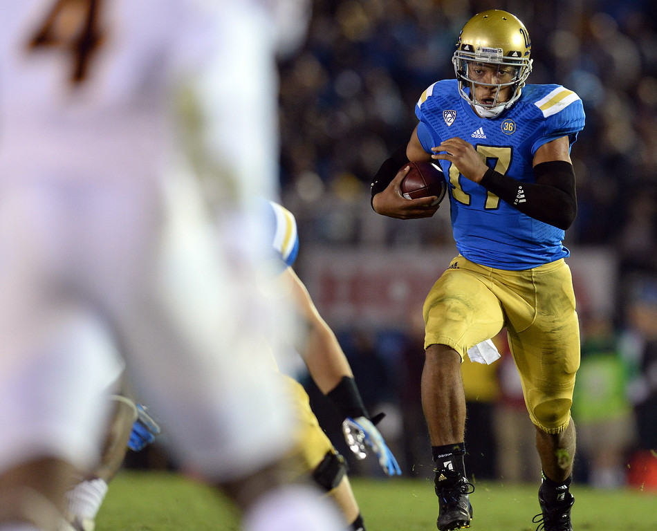 . UCLA�s Brett Hundley #17 looks for some running room during their game against Arizona State at the Rose Bowl Saturday November 23, 2013. (Photos by Hans Gutknecht/Los Angeles Daily News)