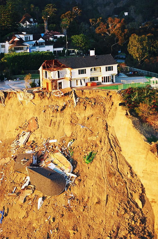. Part of a hillside home overlooking Pacific Coast Highway in Pacific Palisades was lost in a landslide caused by the quake.   Los Angeles Daily News file photo