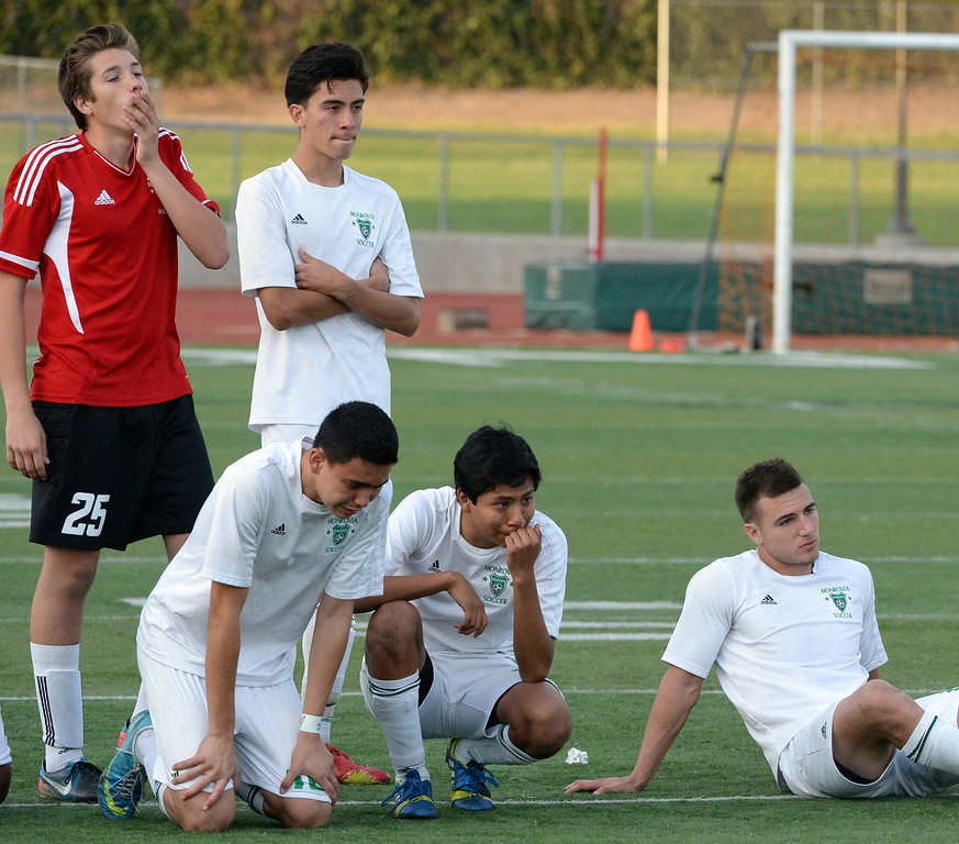. Monrovia looks on as Diamond Bar celebrates after defeating Monrovia on penally kick\'s 3-2 after regulation play and two over-times during a second round soccer match at Monrovia High School in Monrovia, Calif., on Tuesday, Feb.25, 2014.  (Keith Birmingham Pasadena Star-News)