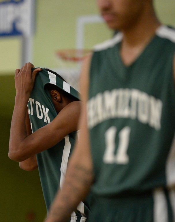 . A Hamilton player hides his face in the final moments of the game. The boys from Eagle Rock defeated Hamilton 68-56 in the City Section Division III Boys basketball final. Los Angeles, CA. March 8, 2014 (Photo by John McCoy / Los Angeles Daily News)