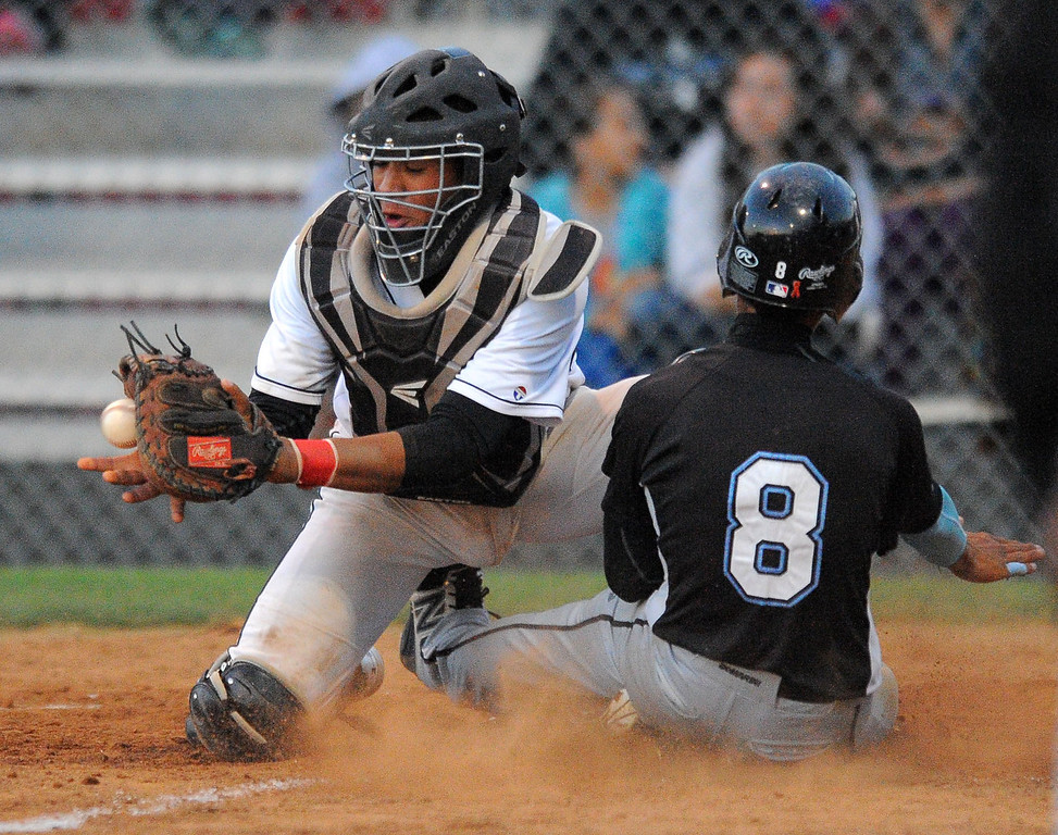 . WILMINGTON - 05/02/2013  (Photo: Scott Varley, Los Angeles Newspaper Group)  Carson vs Banning baseball at Banning High. Carson\'s Eric Bahena beats the throw to Banning catcher Juan Gallardo for a Carson run in the 2nd inning.