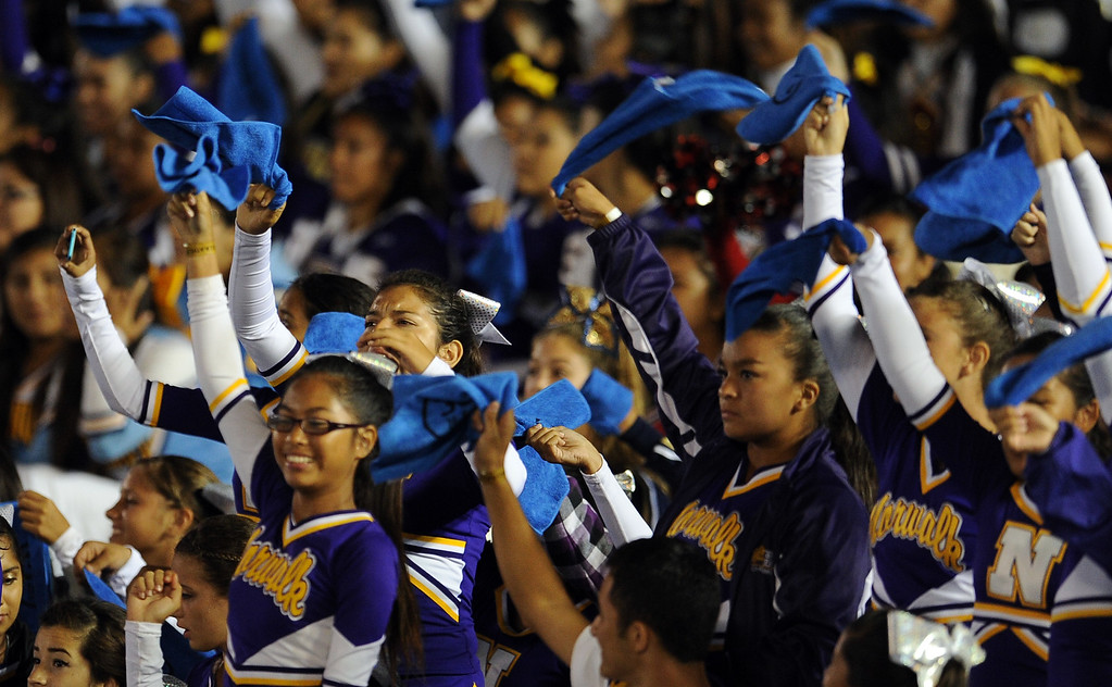 . Young cheerleaders wave towels that were handed out in honor of Nick Pasquale, the UCLA receiver who was struck and killed by a car earlier this month prior to their college football game against New Mexico State in the Rose Bowl in Pasadena, Calif., on Saturday, Sept. 21, 2013.   (Keith Birmingham Pasadena Star-News)