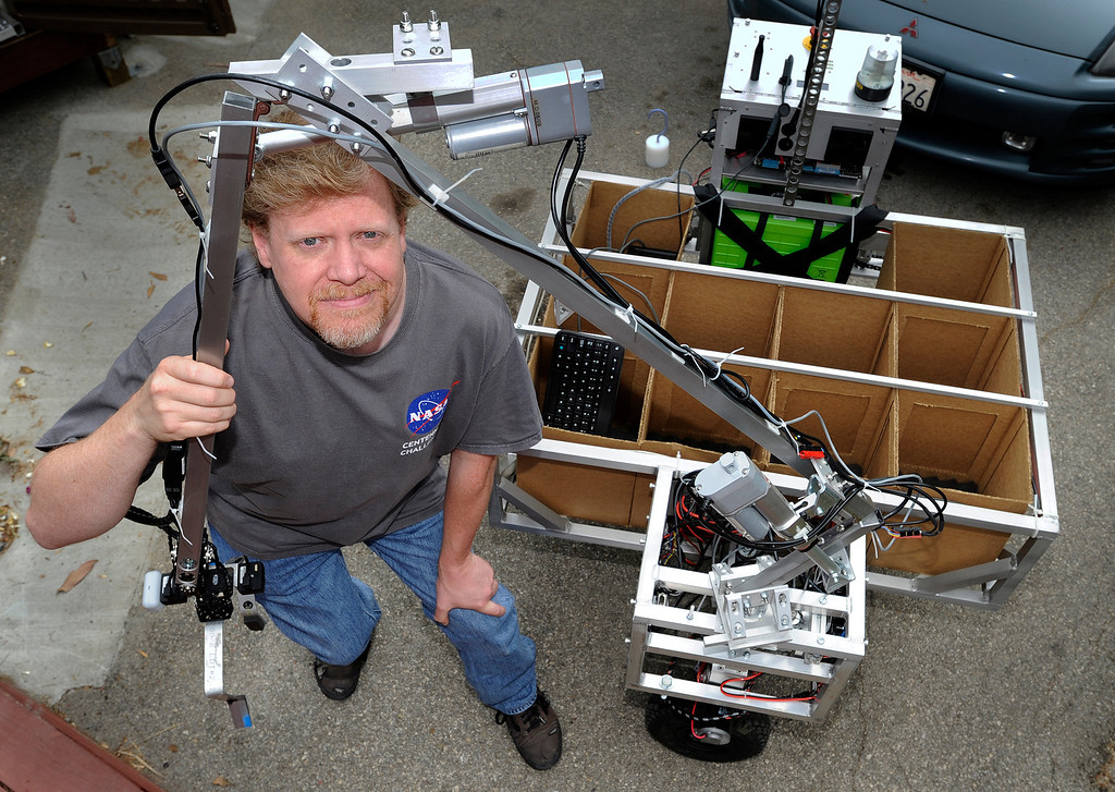 . Jim Rothrock of Wunderkammer Laboratorys has built an autonomous robot for a NASA competition to develop technology that can retrieve rock samples on Mars, which would then be returned to Earth. Wunderkammer is a returning entrant in the competition\'s second year. No one won the $1.5 million prize last year. Topanga, CA 5/16/2013(John McCoy/LA Daily News)