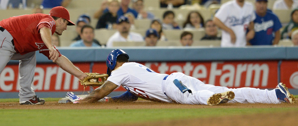 . Matt Kemp is safe at 3rd base in the 6th inning when David Freese gets the throw late. The Dodgers defeated the Angels 5-4. Los Angeles, CA. 8/5/2014(Photo by John McCoy Daily News)