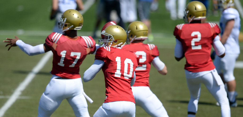 . UCLA quarterbacks during football practice at  Spaulding Field on the UCLA campus Saturday 5, 2014.  (Photo by Hans Gutknecht/Los Angeles Daily News)