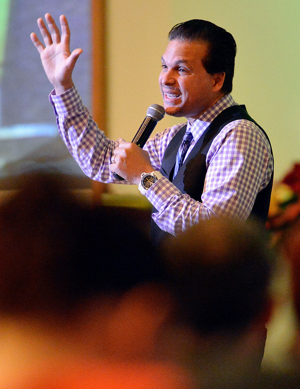 . Way World Outreach Church Pastor Marco Garcia leads his congregation Sunday December 15, 2013 in San Bernardino. He is the co-founder of the rapidly growing church which has been generous in providing for the homeless and others in need. (Will Lester/Inland Valley Daily Bulletin)