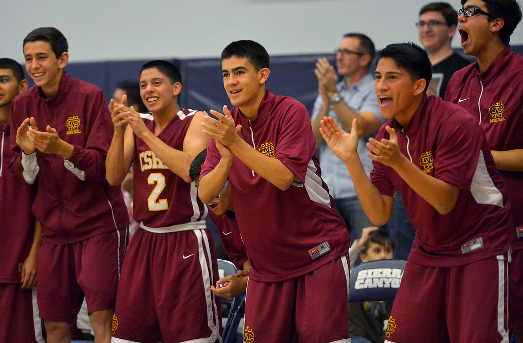 . The Cantwell-Sacred Heart bench cheers on their team against Sierra Canyon during their Division IV state regional semifinal game in Chatsworth, CA March 18, 2014.(Andy Holzman/Los Angeles Daily News)