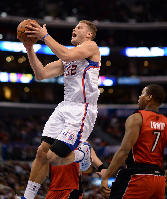 . The Clippers� Blake Griffin #32 drives past the Raptors� Kyle Lowry #7 in his way to the hoop during their game at the Staples Center in Los Angeles Friday, February 7, 2014. (Photo by Hans Gutknecht/Los Angeles Daily News)