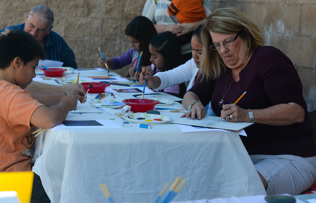 . Redlands residents paint title pices at the Redlands 125th anniversary celebration on Saturday, Nov. 2, 2013. (Photo by Rachel Luna / San Bernardino Sun