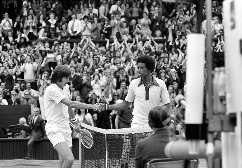 . Arthur Ashe, right, shakes hands with his opponent, last year\'s champion Jimmy Connors, after defeating him in the final match of the men\'s singles championship at Wimbledon, England, July 5, 1975.  (AP Photo)