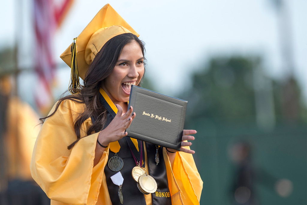 . Bridgett Melendez is all smiles after receiving her diploma during Santa Fe High commencement exercises at Cerritos College June 12, 2013.   (SGVN staff photo by Leo Jarzomb)