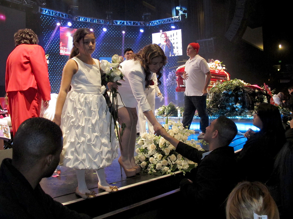 . Fans give white roses to the family members of Jenni Rivera following her memorial service at the Gibson Amphitheatre Wednesday, December 19, 2012, in Universal City. (Michael Owen Baker/L.A. Daily News)