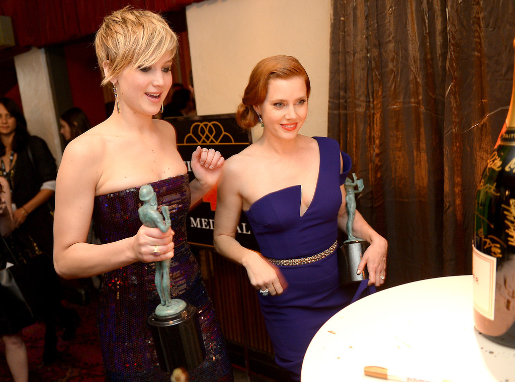 . Jennifer Lawrence and Amy Adams backstage at the 20th Annual Screen Actors Guild Awards  at the Shrine Auditorium in Los Angeles, California on Saturday January 18, 2014 (Photo by Michael Owen Baker / Los Angeles Daily News)