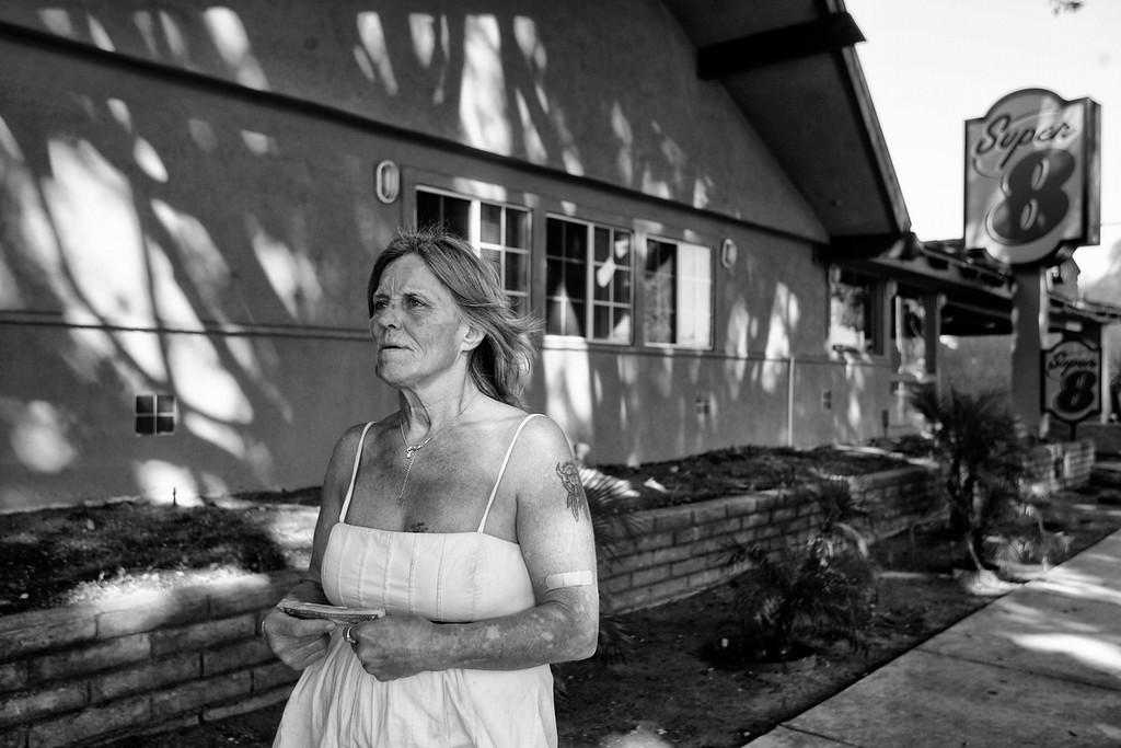 . Dorothy walks along Colorado Boulevard, back to her motel room.