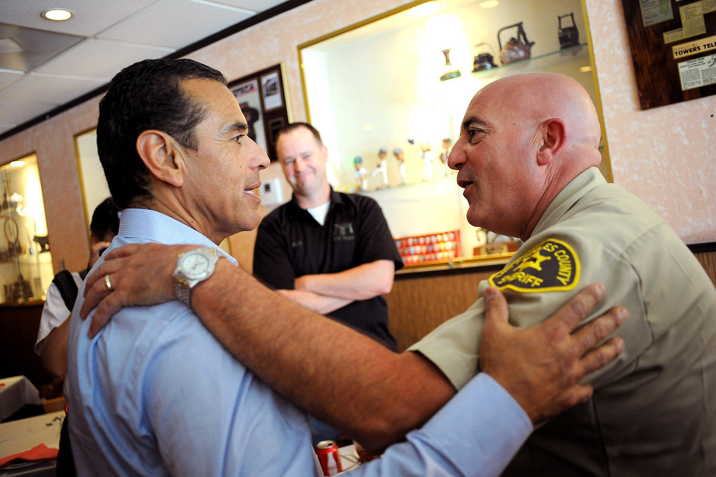 . Mayor Antonio Villaraigosa chats with Ralph Ornelas at Yang Chow Restaurant in Los Angeles, CA June 28, 2013.  Villaraigosa spent the day visiting some of his favorite loactions during his 24-hour goodbye tour.(Andy Holzman/Los Angeles Daily News)