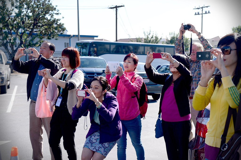 . Visitors take pictures of students from Harbin Normal University in China as they pose with Immaculate Conception Catholic School students during their visit to the Monrovia school Wednesday, January 22, 2014. (Photo by Sarah Reingewirtz/Pasadena Star-News)