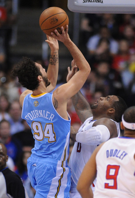 . Clippers#0 Glen Davis guards Nuggets #94 Evan Fournier in the first half. The Los Angeles Clippers took on the Denver Nuggets in a regular season NBA game. Los Angeles, CA. 4/15/2014(Photo by John McCoy / Los Angeles Daily News)