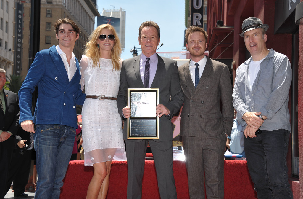 ". Bryan Cranston, center, star of the television series ""Breaking Bad,\"" poses with fellow cast members, left to right, RJ Mitte, Anna Gunn, Aaron Paul and Bob Odenkirk after Cranston received a star on the Hollywood Walk of Fame on Tuesday, July 16, 2013 in Los Angeles. (Photo by John Shearer/Invision for AMC/AP Images)"