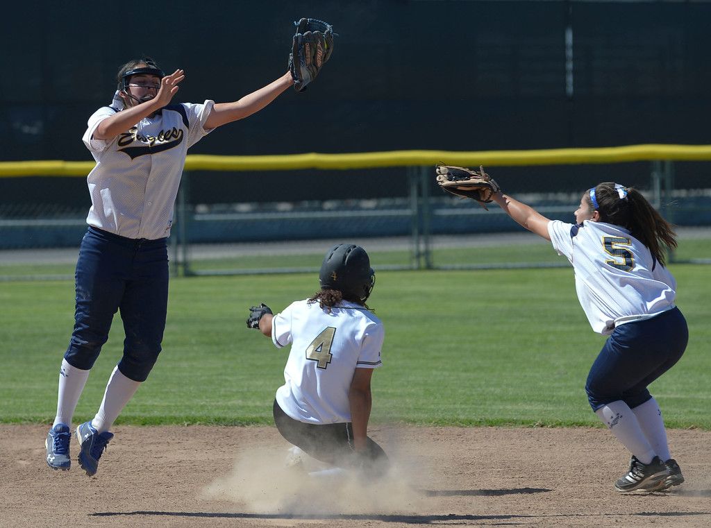 . Peninsula\'s Brooke Vines (4) has no trouble stealing second through  Arroyo Grande\'s Charlette Yracheta (12) and Ramie Castilleja (5) in a CIF Southern Section Division III wild-card softball game in Rolling Hills Estates Tuesday. Peninsula won the game 13-0. 20130514 Photo by Steve McCrank / Staff Photographer
