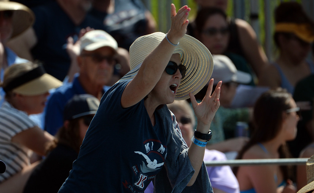 . A fan cheers on the swimmers in the 200 yard freestyle during the Division 2 CIF Southern Section Swimming Championships in the Riverside Aquatics Complex at Riverside City College in Riverside, Calif., on Saturday, May 17, 2014.