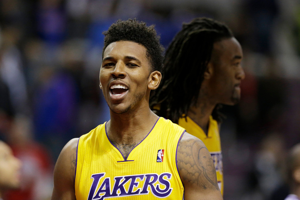 . Los Angeles Lakers  forward Nick Young reacts after the Lakers defeated the Detroit Pistons 106-102 during the second half of an NBA basketball game at the Palace in Auburn Hills, Mich., Friday, Nov. 29, 2013. (AP Photo/Carlos Osorio)