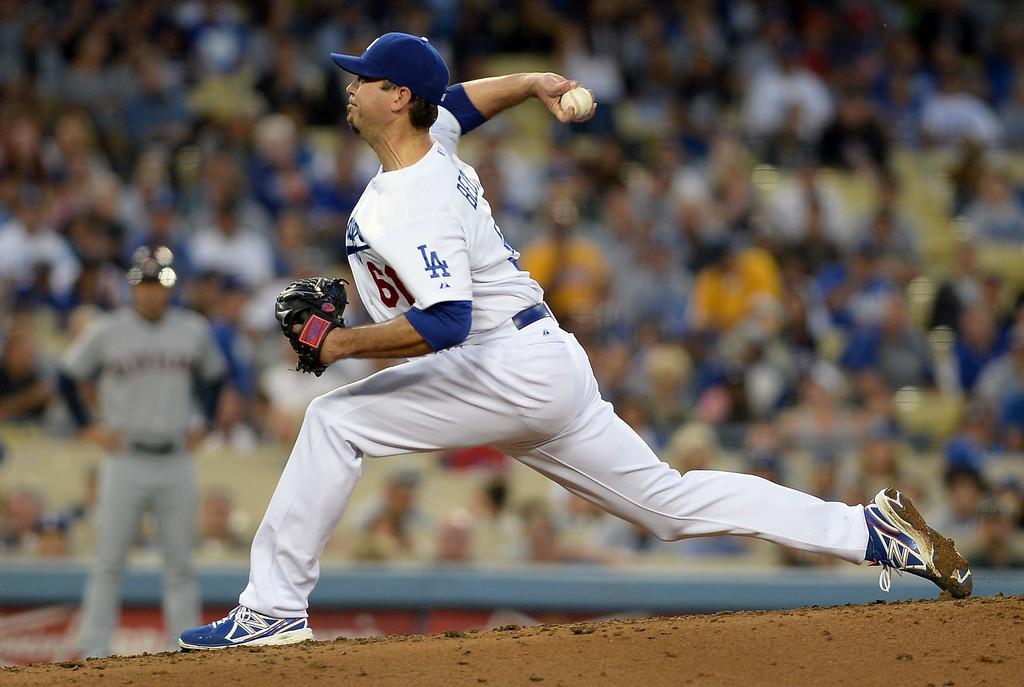 . Los Angeles Dodgers pitcher Josh Beckett delivers a pitch against the Cleveland Indians July 1, 2014 in Los Angeles.(Andy Holzman/Los Angeles Daily News)