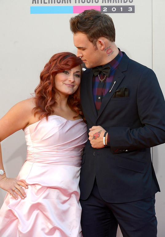 . Singer James Durbin and wife Heidi Durbin arrives to the American Music Awards  at the Nokia Theatre in Los Angeles, California on Sunday November 24, 2013 (Photo by Andy Holzman / Los Angeles Daily News)