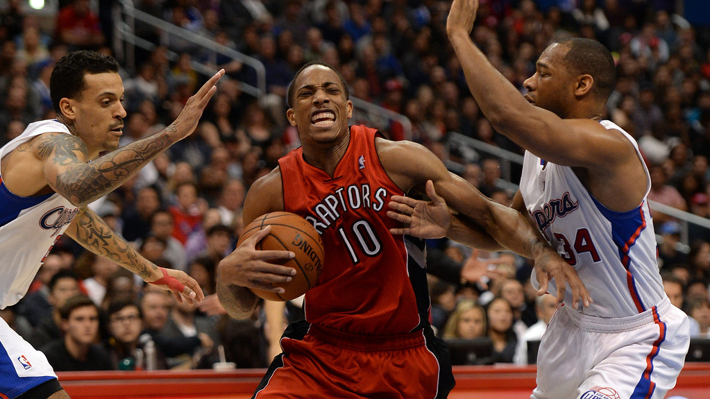 . The Raptors� DeMar DeRozan #10 drives between Clippers� Matt Barnes #22 and Willie Green #34 during their game at the Staples Center in Los Angeles Friday, February 7, 2014. (Photo by Hans Gutknecht/Los Angeles Daily News)