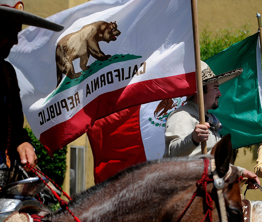 . Traditional Mexican Cowboys carry the colors during the Annual Canoga Park Memorial Day Parade as they marched down Sherman Way from Owensmouth east to Mason Street where it concluded at the First Baptist Church. Canoga park, CA 5/27/2013(John McCoy/LA Daily News)