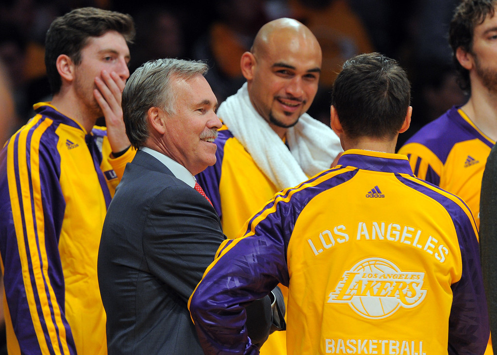 . Lakers coach Mike D\'Antoni celebrates with his players late in the 4th qtr in the NBA season opener between the Lakers and Clippers at Staples Center in Los Angeles, CA on Tuesday, October 29, 2013. 
