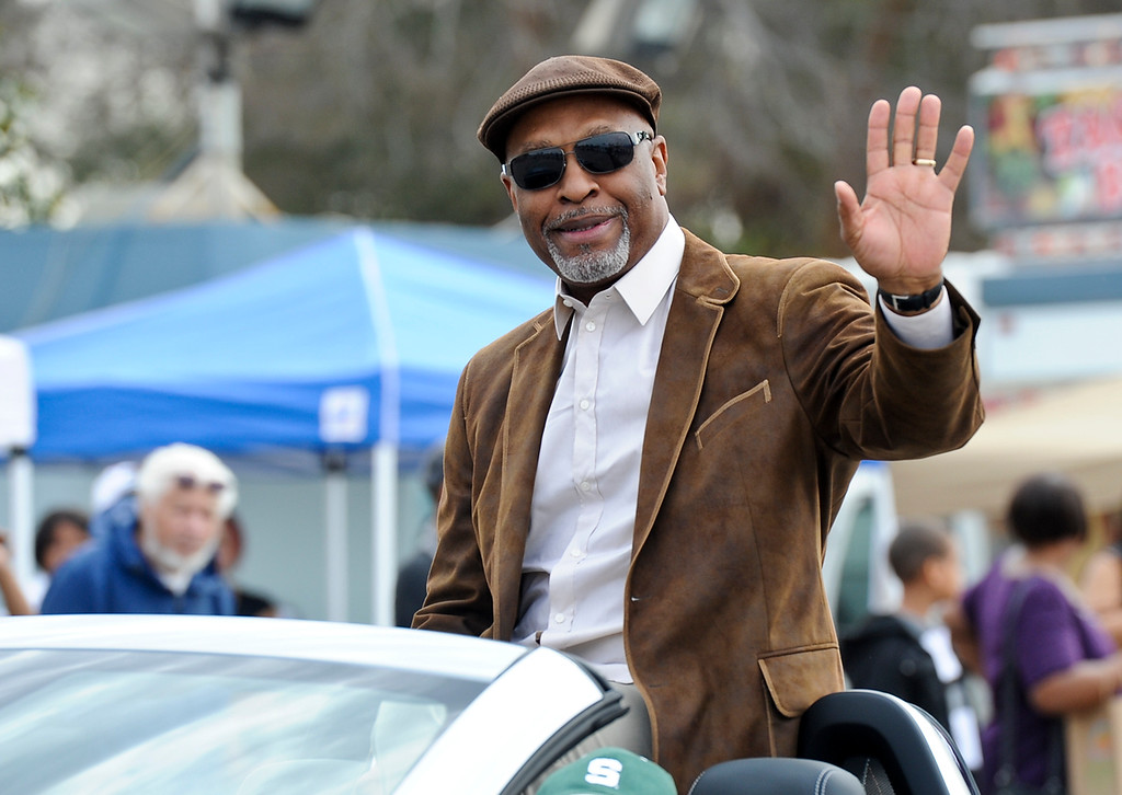 """. Parade grand marshal Jim Pickens Jr., of ABC\'s drama \""""Grey\'s Anatomy,\"""" waves to the crowd during the 44th annual Black History Parade at the National Orange show in San Bernardino on Saturday, Feb. 2, 2013. Hosted by the Southern California Black chamber of Commerce, this year\'s parade theme marked tribute to the 50th anniversary of Dr. Martin Luther King Jr. speech, \""""I Have a Dream.\""""  (Staff file photo/The Sun)"""