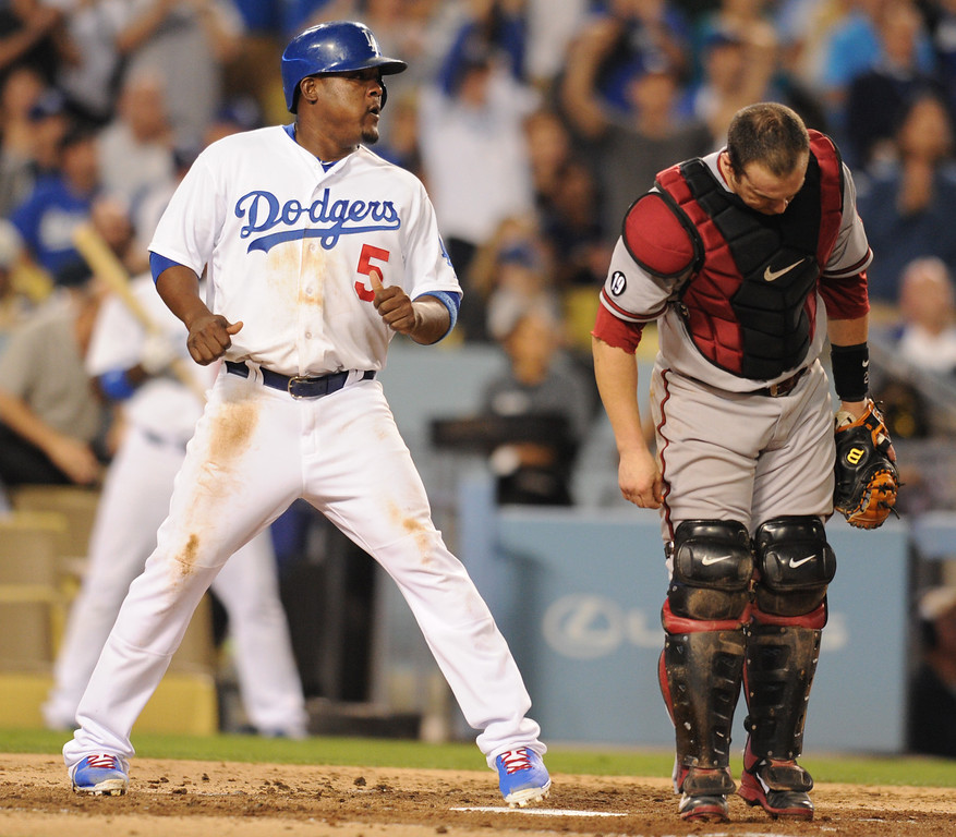 . Juan Urive looks back at Dback catcher Miguel Montero after he scored on a bunt by Dodger pitcher Edinson Volquez in the 2nd inning. The Dodgers played the Arizona Diamondbacks at Dodger Stadium in Los Angeles, CA. 9/10/2013. photo by (John McCoy/Los Angeles Daily News)