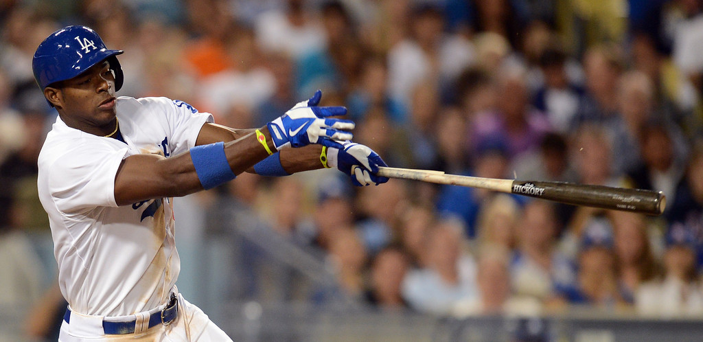 . The Dodgers\' Yasiel Puig #66 has his bat crack during their game against the Reds at Dodger Stadium in Los Angeles Saturday, July 27, 2013. The Dodgers beat the Reds 4-1. (Hans Gutknecht/Los Angeles Daily News)