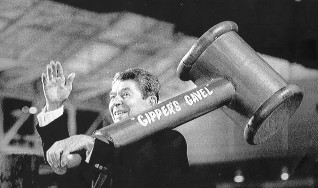 . 8/14/88 - New Orleans: President Ronald Reagan  waves to  the crowd as he holds a giant gavel over his shoulder Sunday in New Orleans during his speech at the New Orleans Convention Center. Reagan told the crowd that America needed the strength and true grit of George Bush as president.  (Los Angeles Daily News file photo)