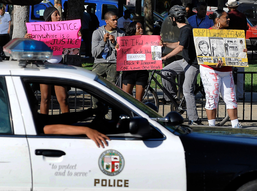 . Crowds gather to protest while a heavy presence of Los Angeles Police Officers patrols the area around Leimert Park at the intersection of, Crenshaw Boulevard and Vernon in Los Angeles, CA. 7/16/2013(John McCoy/LA Daily News)