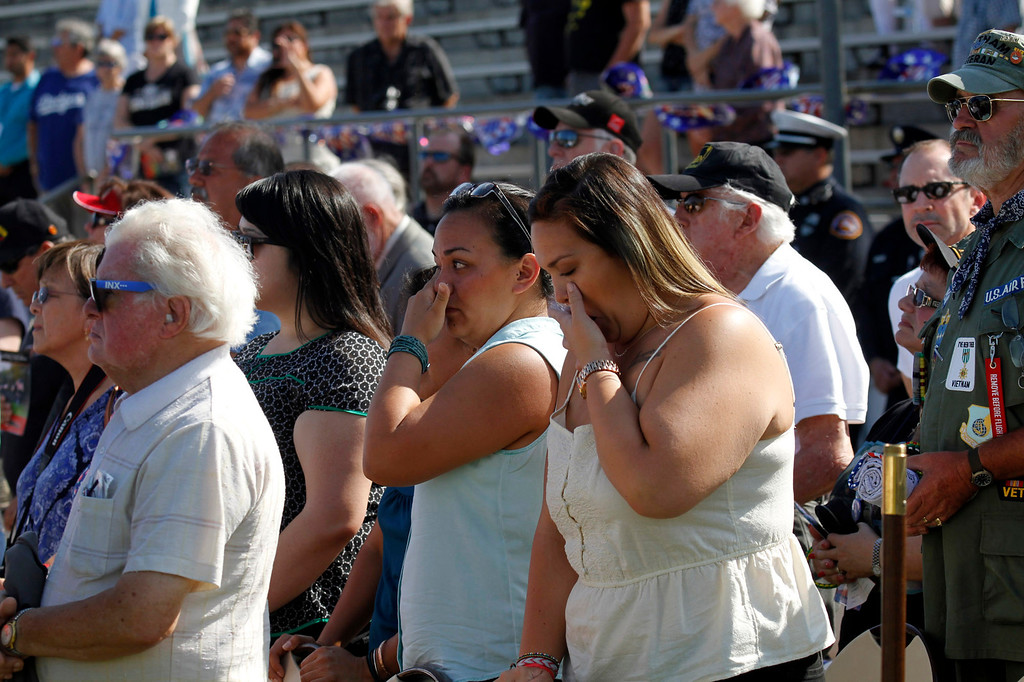 """. Guests are brought to tears during the \""""Last Bugle Call\"""" during the Vietnam Veterans Memorial \""""The Wall That Heals\"""" Closing Ceremony event, at La Habra High School, in La Habra, Sunday, July 14, 2013. (SGVN/Correspondent Photo by James Carbone)"""