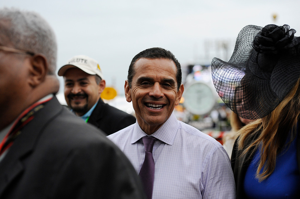 . Los Angeles Mayor Antonio Ramon Villaraigosa  speaks to race fans before the 138th Preakness Stakes horse race at Pimlico Race Course, Saturday, May 18, 2013, in Baltimore.(AP Photo/Mike Stewart)