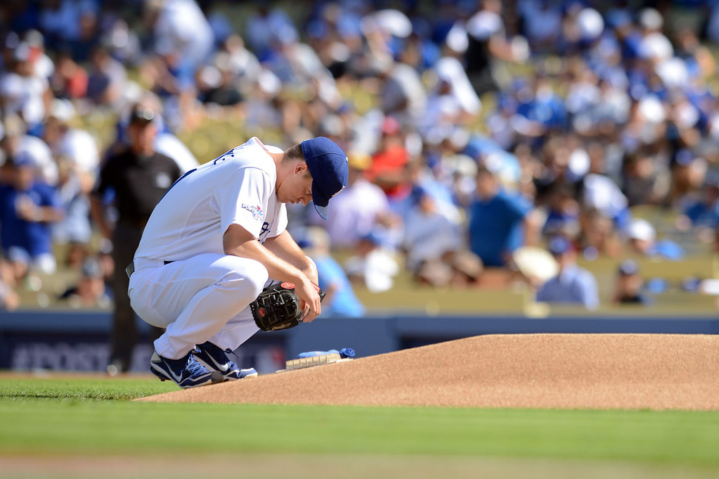 . The Dodgers\' starting pitcher Zack Greinke prepares to face the Cardinals in the 1st inning of game 5 of the NLCS at Dodger Stadium Wednesday, October 16, 2013.(David Crane/Los Angeles Daily News)