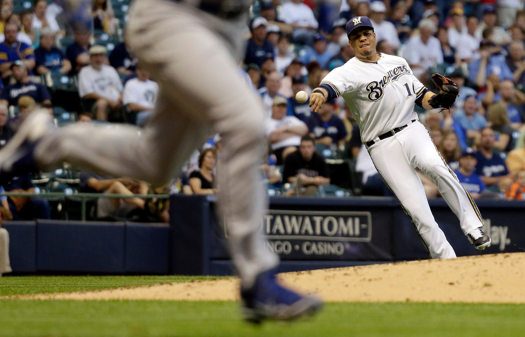 . Milwaukee Brewers third baseman Aramis Ramirez makes a late throw on a ball hit by Los Angeles Dodgers\' Zack Greinke during the third inning of a baseball game Tuesday, May 21, 2013, in Milwaukee. (AP Photo/Morry Gash)