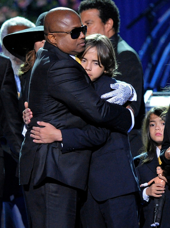 . In this July 7, 2009 file photo, Randy Jackson, left, embraces his nephew Prince Michael I during the memorial service for Michael Jackson at the Staples Center in Los Angeles. (AP Photo/Mark J. Terrill, file)