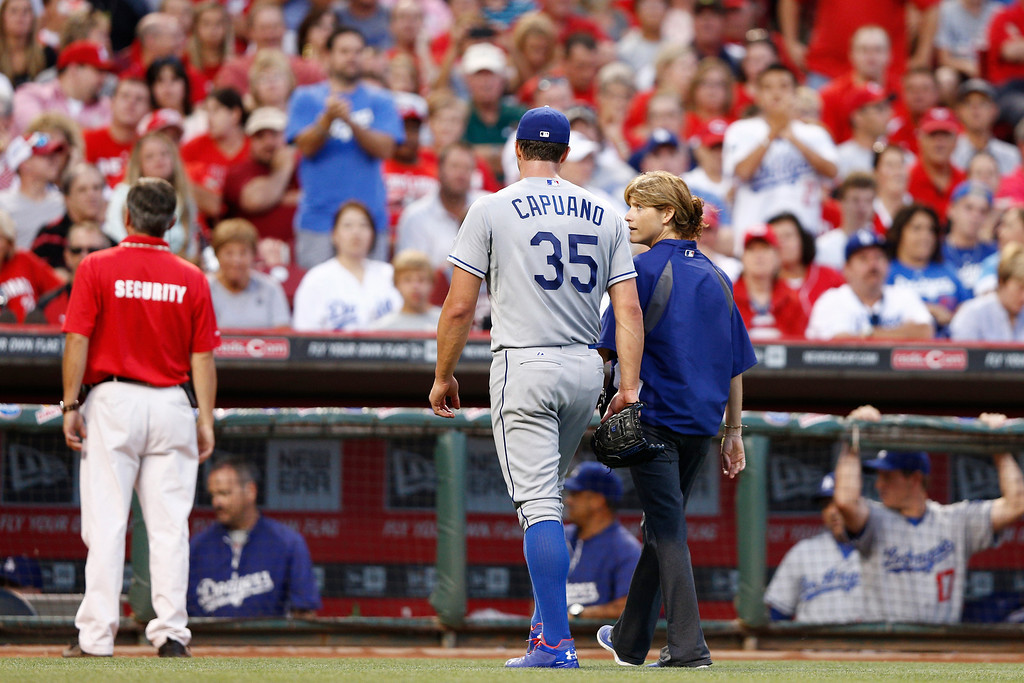 . CINCINNATI, OH - SEPTEMBER 6: Starting pitcher Chris Capuano #35 of the Los Angeles Dodgers leaves the game after suffering an injury in the second inning against the Cincinnati Reds at Great American Ball Park on September 6, 2013 in Cincinnati, Ohio. (Photo by Joe Robbins/Getty Images)