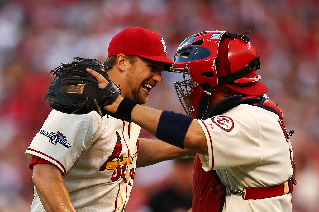 . ST LOUIS, MO - OCTOBER 12:  Trevor Rosenthal #26 of the St. Louis Cardinals celebrates with Yadier Molina #4 after their 1 to 0 win over the Los Angeles Dodgers during Game Two of the National League Championship Series at Busch Stadium on October 12, 2013 in St Louis, Missouri.  (Photo by Elsa/Getty Images)
