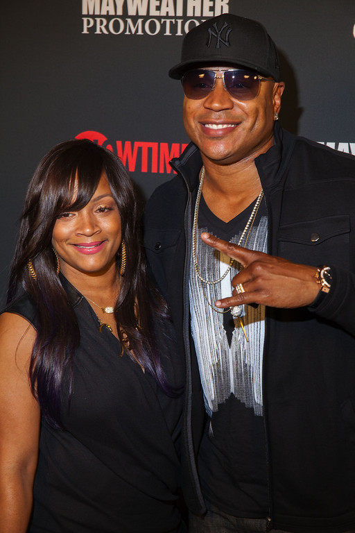 . LL Cool J & wife Simone Smith arrive at the VIP Pre-Fight Party for the One: Mayweather vs. Canelo Fight at the MGM Grand Garden Arena on Saturday, Sept. 14, 2013 in  Las Vegas. (Photo by Eric Jamison/Invision/AP)