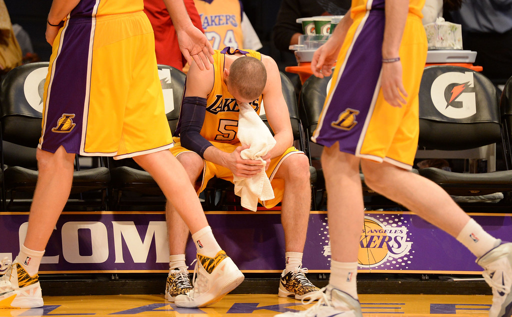 . Lakers\' Steve Blake hangs his head low as his team walks off the court after losing to the Jazz 79-96 in a NBA Western Conference basketball game at the Staples Center Tuesday, February 11, 2014, Los Angeles, CA.  