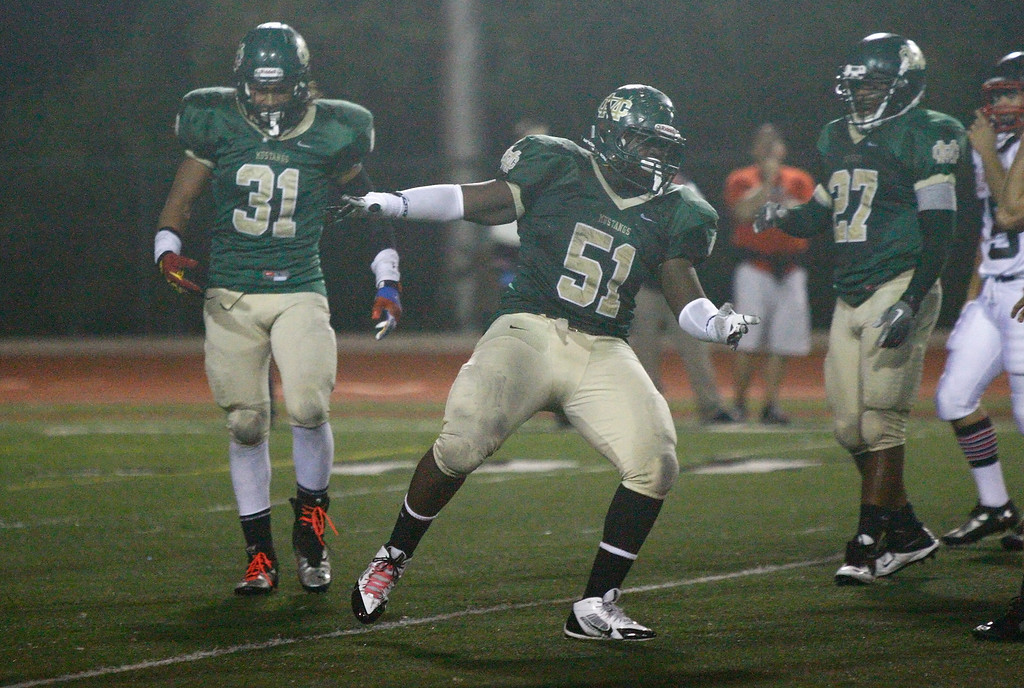 . Khalil Sonko #51 of Mira Costa celebrates after making a tackle for a loss against Palos Verdes during a Bay League matchup at Mira Costa High School on Friday, October 18, 2013 in Manhattan Beach, Calif.  (Michael Yanow / For the Daily Breeze)